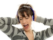 girl with headphones singing with all her heart to the music.